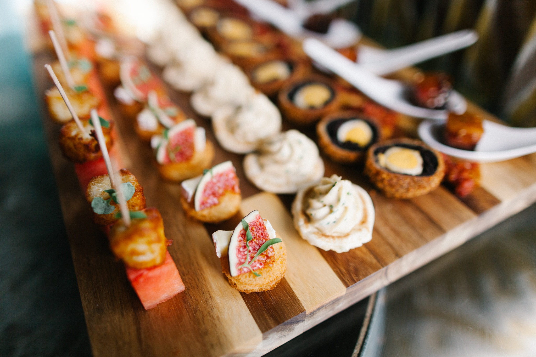 wooden platter of canapes at Three Choirs Vineyards wedding reception